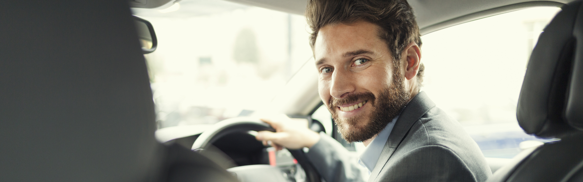 Smiling man in car